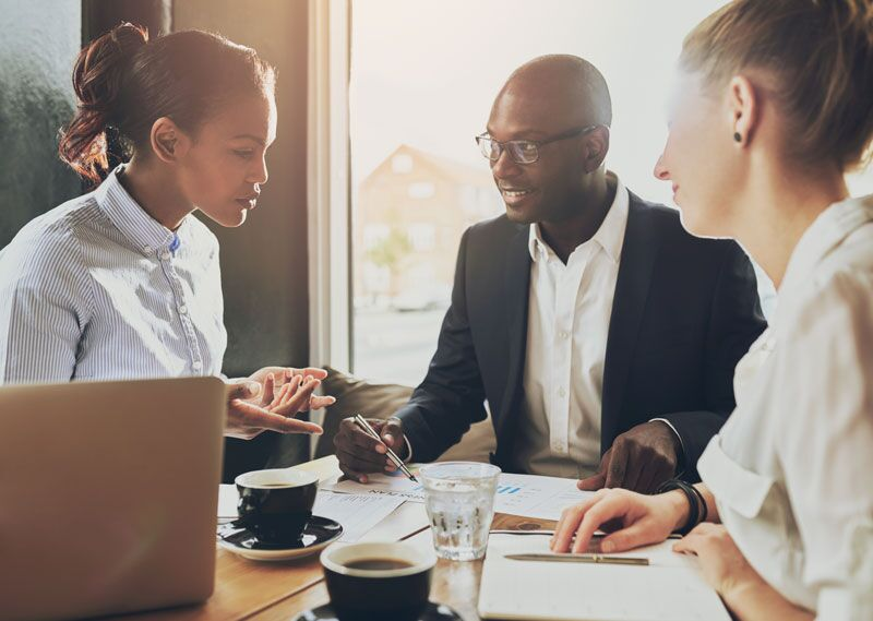employees working with business mentor